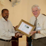 Dr Bransford receives a certificate of appreciation for his years of service